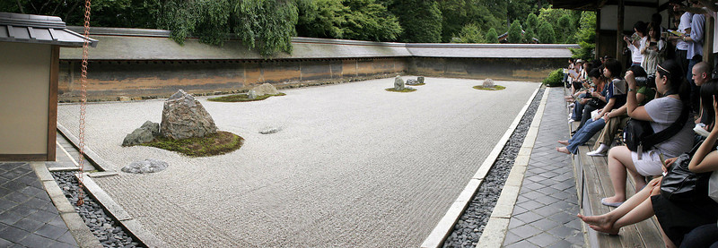 Ryoan-Ji was established in 1450.  Its rock garden is considered by many to be the ultimiate expression of Zen Buddhism.  Lots of visitors, but all very quiet; you're supposed to engage in silent contemplation.