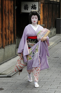 A Geisha in the Gion district, on her way to her evening place of work.