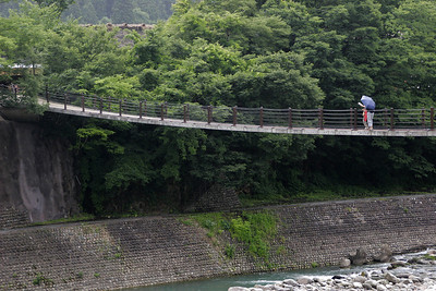 We stop for the middle of the day in a preserved historical village in the Shirakawa-go region of the Shokawa Valley.  Here we cross a long footbridge to enter the village.