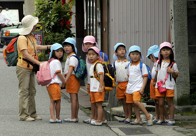 School kids get ready for an outing in Kanazawa.
