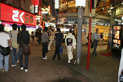 The traditional mixes with the modern in the Shibuya evening shopping crowd.