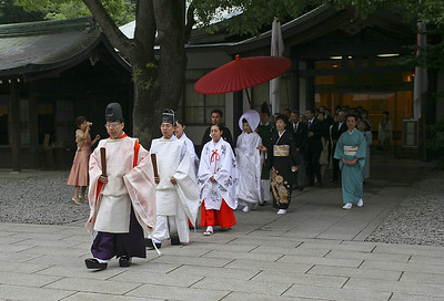 At the Meiji Shrine we came across two weddings taking place.  This one is just about to go inside the temple for the ceremony.