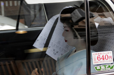 A passing car in the Geisha district yielded this quick shot portrait.