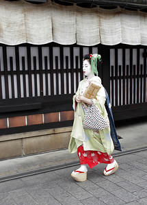 Gion Geisha district of Kyoto.  We arrive in the early evening as geishas walk to work.