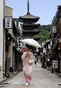 Traditional kimono with the ubiquitous umbrella.