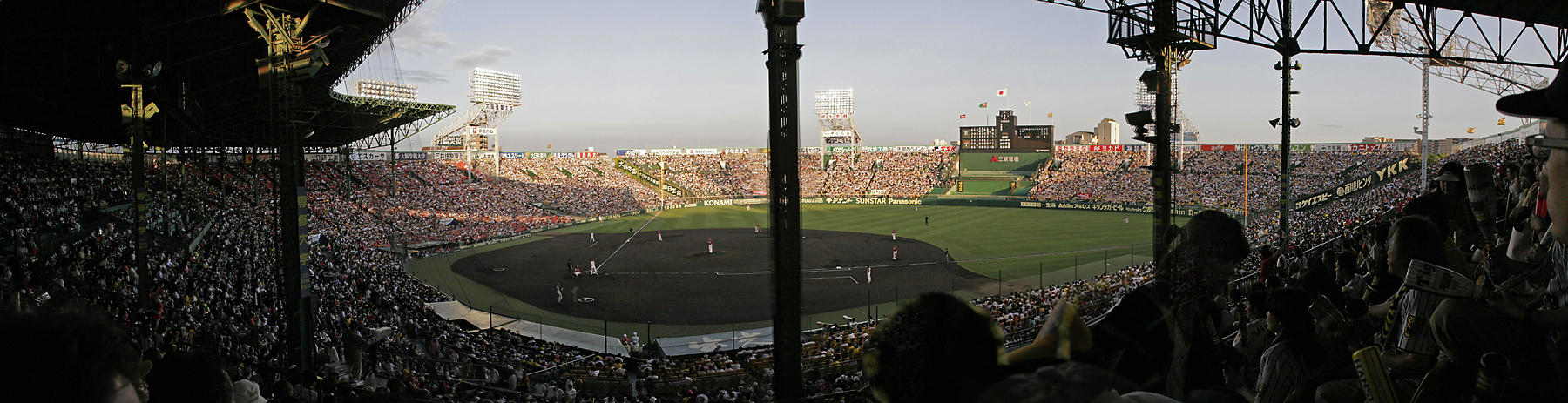 The stadium holds about 50,000.  The stadium was full for a weeknight game in the middle of the season for a team that was in the middle of the standings.  (a 4-image panorama)