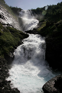 Halfway down our descent to Flam, we stopped for a look at Kjosfossen Falls, 305 feet high with an awesome volume of water.