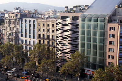The view from the rooftop reveals other very modern pieces of architecture nearby.  It is said that Gaudi's creation attracted other creative architects to build in the area.