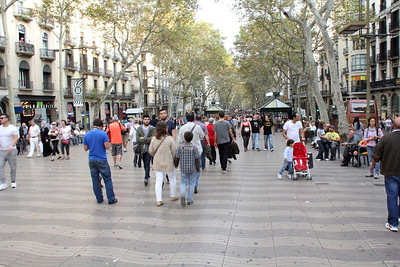 "From Plaça de Catalunya, we started down the long and famous ""Las Ramblas"", a two mile pedestrian district leading to the harbor."