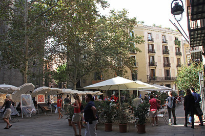 Down on Plaça de Sant Josep Oriol.  Our hotel is the building at the end, and our room behind the large tree.  Note that Barcelona is in Catalunya, where plaza is spelled with a ç instead of the z more familiar to we Californians.
