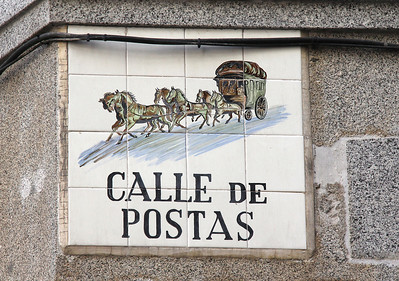 "The medieval street signs, this one showing a postal coach, included pictures so the illiterate could ""read"" them."