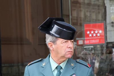 A civil guardsman at the County Governor's office wears the traditional hat with the square back.  It's said the square back is designed so the men can lean against the wall while enjoying a cigarette.