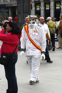 A street performer solicits posing business on the Puera del Sol plaza.   I think he was trying to portray King Juan Carlos.