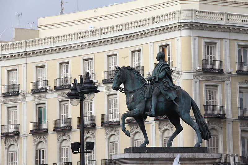 """Puerta del Sol ... a statue of Charles III (1716-1788), whose enlightened urban policies earned him the nickname of """"the best Mayor of Madrid""""."""