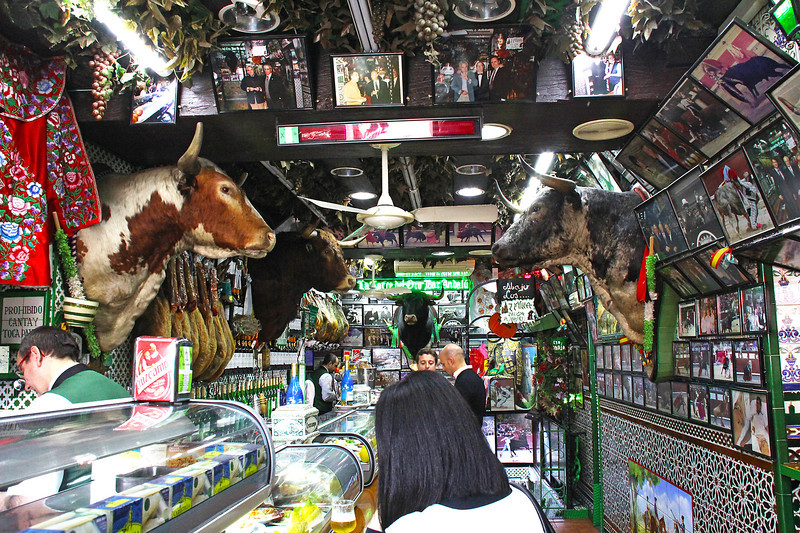 """The interior of """"La Torre del Oro Bar Andalú."""", a """"temple"""" of bull fighting.  Full of stuffed bull heads and numerous photos from very famous bull fights."""