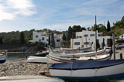 Fishing boats along the beach of Portlligat Bay, with Dalí's house at the left.