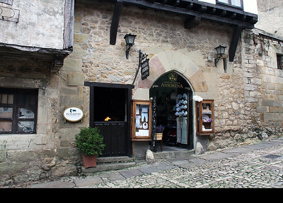 """Our hotel was the """"Posada Ansorena"""".  One finds the hotel manager in the ground floor shop on the right, and then walks up steep stairs through the door on the left."""