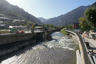 The river flows down through Andorra via the narrow valley from the north, and then out to the south into Spain.