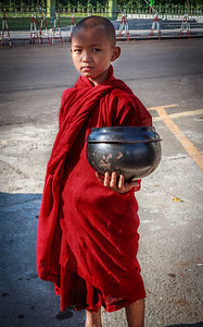 Young Monk Collecting Alms
