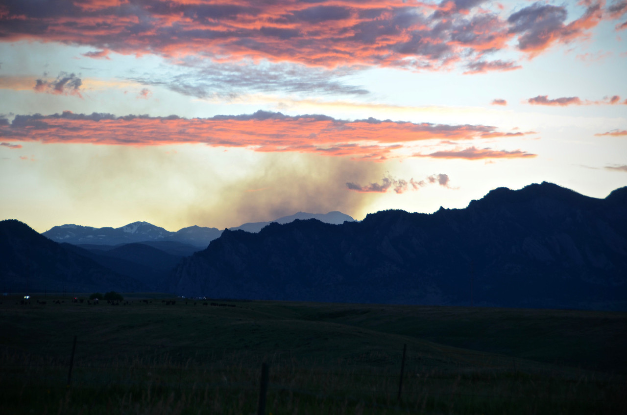 Smoke from Nederlands fire eat sunset with flatirons in foreground