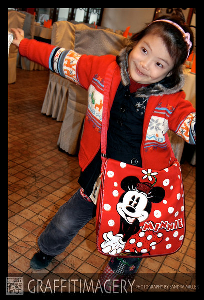 Mickals daughther Minnie.  I brought her a bunch of Minne Mouse things from the Disney store.  Wow was she happy