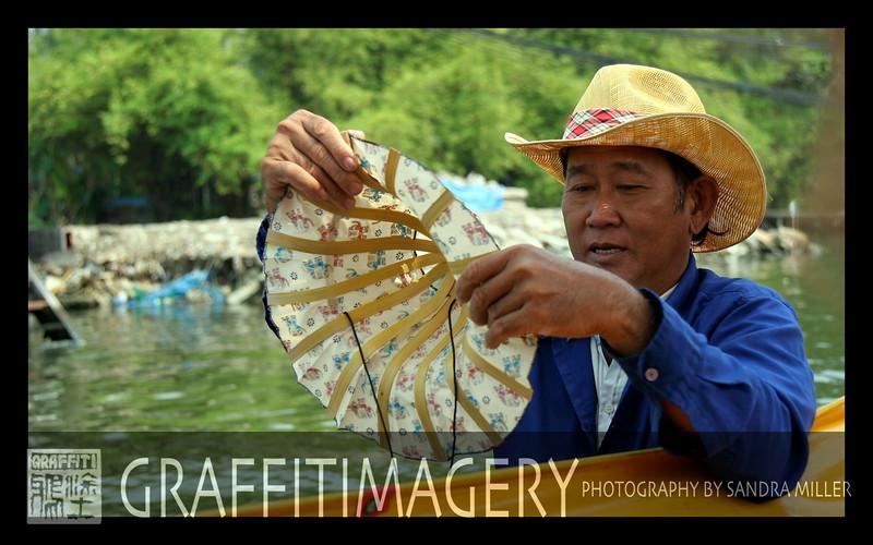 Vendor in Bangkok selling folding hats