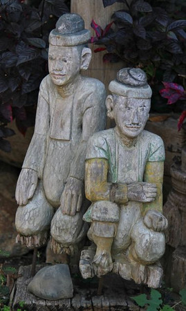 Teak carvings in front of a reataurant
