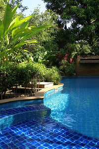 The stunning pool at Baan Orapin.  The waterfall at the end runs most of the time