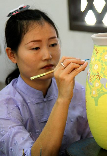 My favorite bird painting girl is still doing her magic on the celadon pots