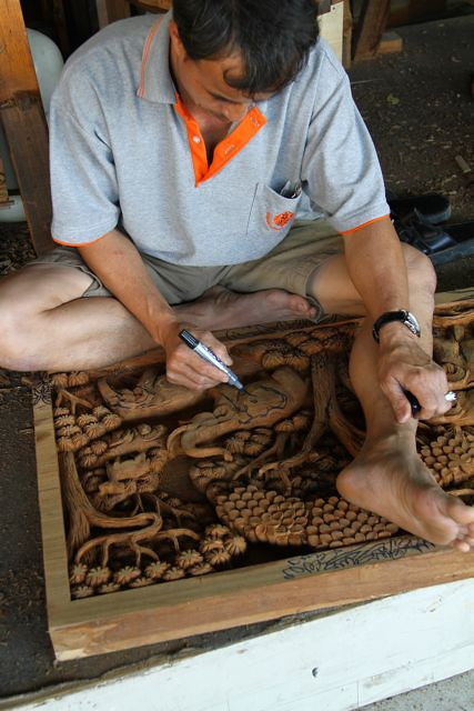 This is at the teak carvers where all the panels etc are carved by masters.  This man was drawing his next layer out with a felt tip pen