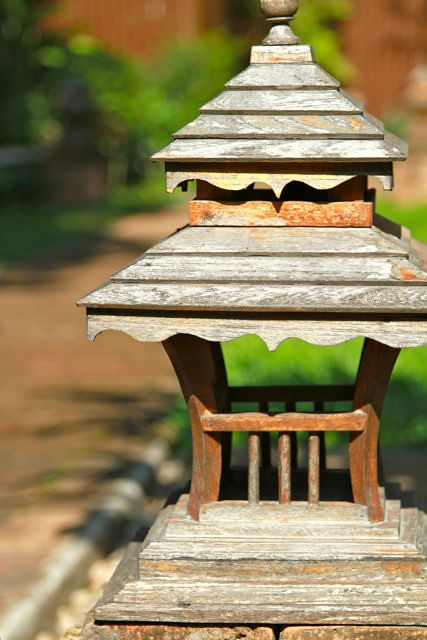 One of the teak lanterns lighting the pathway at Baan Orapin