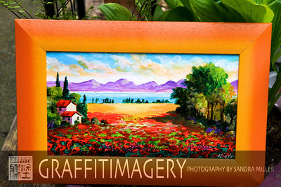 I purchased this sweet smaller painting from the artist in a little village outside of Verona.  The poppies were in full bloom in Italy and I just loved that the painting depicted the poppy fields