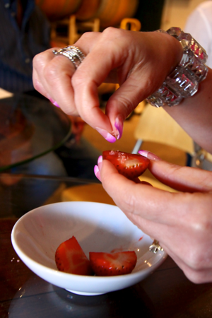 Leslie putting the salt from Seuferts on the strawberry