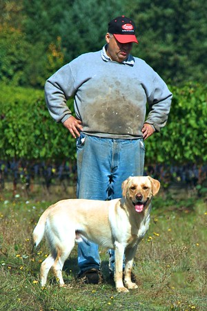 The man behind the grapes!!  This was the wonderful farmer and one of his many dogs