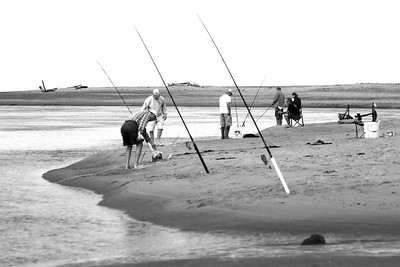 LOW TIDE IN THE EARLY MORNING..FISHERMEN AND CRABBERS ARE SETTING THEIR LINES  Oregon Coast August 2012