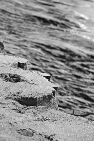 """""""LIVING ON THE EDGE"""" Another low tide shot...You can see Lillians footprint on the crumbling cliff of sand"""