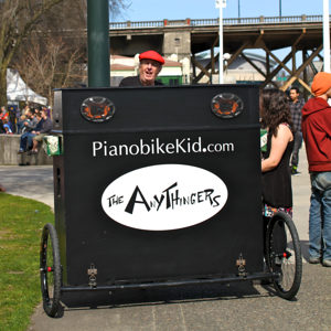 This was new for the season!!! A guy on a bike playing piano...only in Portland