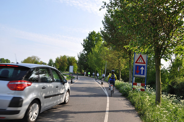 Typical road shared with bikes...one lane shared between cars going in opposite directions.