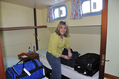 For the record, cabin 5.  Tight, but quiet and comfortable (heat and AC in every room).  Bags go under beds.