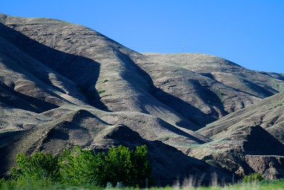 DAY ONE  The late afternoon revealed deep shadows on the Idaho hillsides.  It was like am incredible serpent winding across the landscape.  On our drive from Portland Oregon to our hotel in  Clarkston Idaho