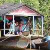 A kids in their houseboat in floating village on a lake near Siem Reap Cambodia.
