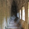 lower hallways filled with streams of sunlight at the Bayon Temple in Siem Reap Cambodia