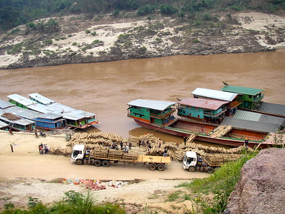 Picking up villagers and dropping off supplies along the muddy banks of the Mekong river in Laos during our 2 day voyage downstream from Huay Xai to Luang Prabang on a long wooden boat packed with locals and backpackers.  Very very wild and remote area that had some incredible sights along the way.  Painfuly slow, loud and cold way to travel and i would never do it again but i would HIGHLY reccomend it.  Well worth it!!