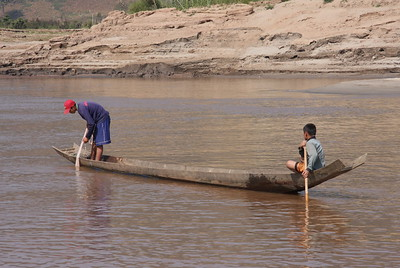Picking up villagers and dropping off supplies along the banks of the Mekong river during our 2 day  voyage downstream.  Very very wild and remote area that had some incredible views along the way.  Painful slow way to travel and i would never do it again but i would HIGHLY reccomend it