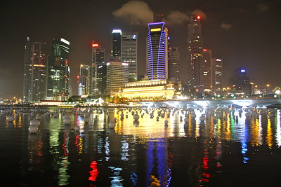 Downtown Singapore and harbor with floating beach balls lit up as an art exhibit for NYE