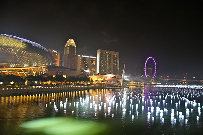 Downtown Singapore, Singapore FLyer and harbor with floating beach balls lit up as an art exhibit for NYE