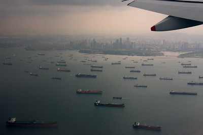 The Straits of Malacca and downtown Singapore with all the parked cargo ships