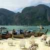 Boats on beach at low tide on Ko Phi Phi Islands in Southern Thailand