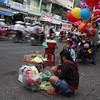Street vendors selling food, drinks and other stuff on the busy streets of Saigon Vietnam