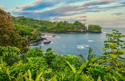 A beautiful secluded bay near Hilo, Hawaii, with lush tropical vegetation and picturesque scenery.